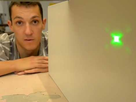 [Andy Marmery displays a laser diffraction pattern]