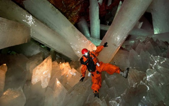 Researcher in protective gear among the crystals.